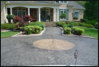 include a design at intersecting points of your driveway to create a focal point commonly chosen items are compass designs logos address numbers - Concrete Driveway Design Ideas