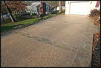 choose two types of patterns or finishes to give your driveway a unique look in this example exposed aggregate was used in the fields and a patterned - Concrete Driveway Design Ideas